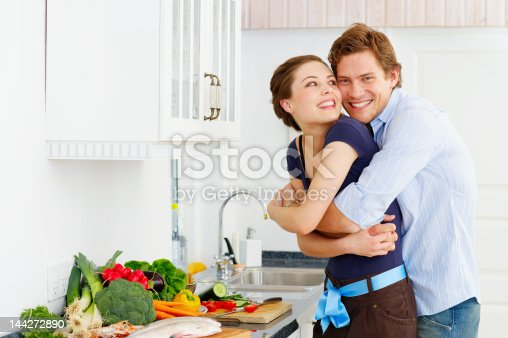 istock Couple loving in their kitchen 144272890
