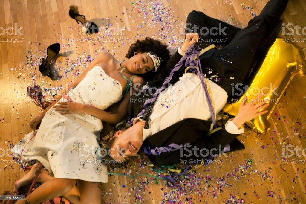 Couple lying down on the floor stock photo