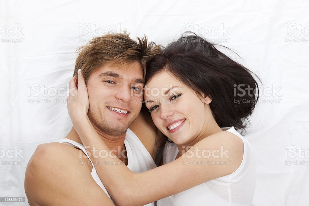 couple lying in bed royalty-free stock photo