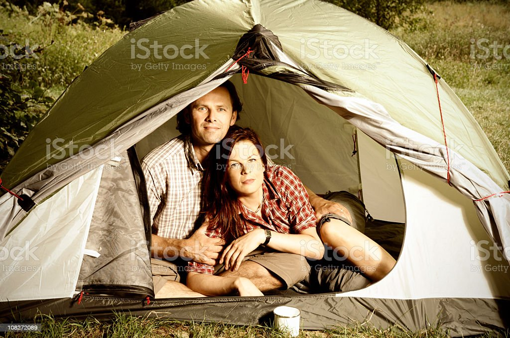 Couple lying in tent - camping serie royalty-free stock photo