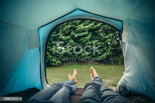 Couple lying in tent