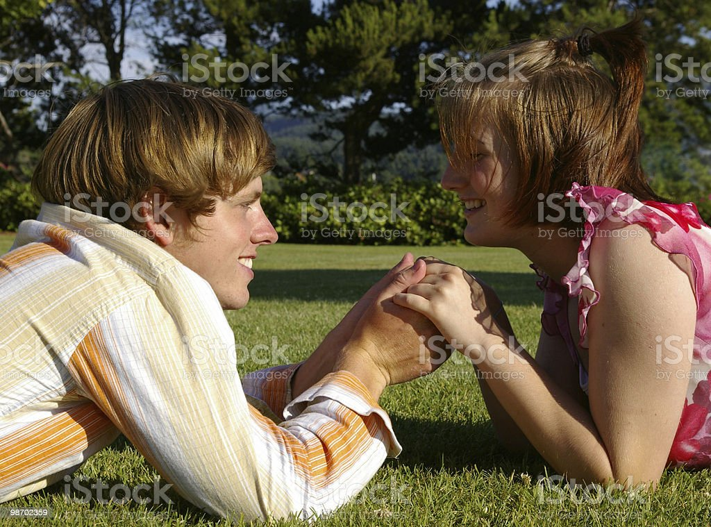 Couple Lying in the Park royalty-free stock photo