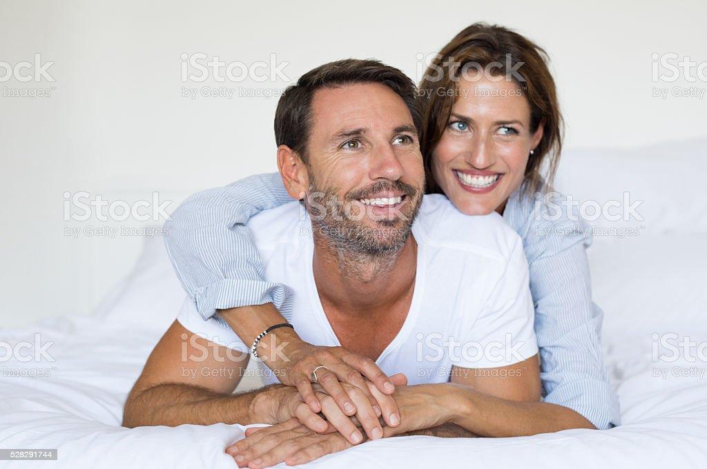 Couple lying on bed stock photo