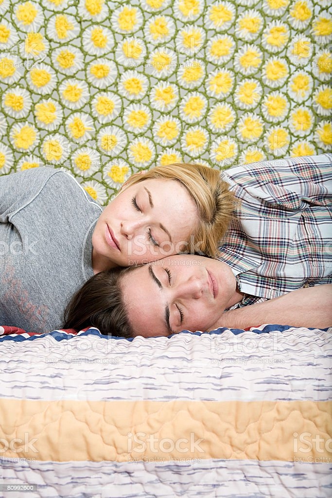 Couple lying on bed 免版稅 stock photo