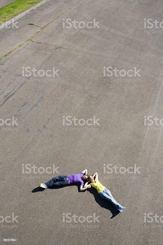 Couple lying on floor outdoors royalty-free stock photo