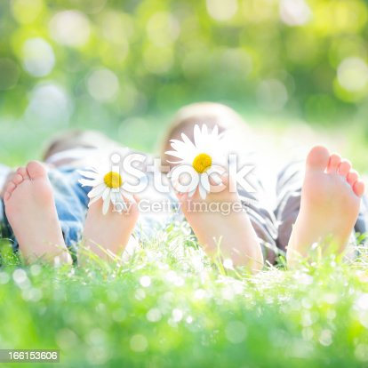 480122543 istock photo Couple lying on grass 166153606