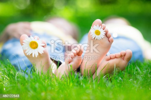 istock Couple lying on grass 480122543