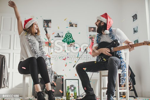 849362192 istock photo Couple making a christmas song 849332486