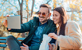 istock Couple making a selfie with tablet in the autumn park. 639907056