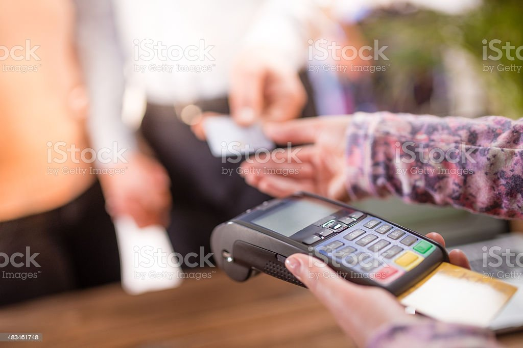 Couple making credit card payment stock photo