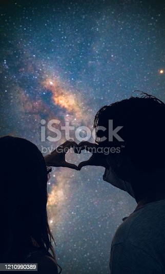 815224118 istock photo Couple making heart shape under the starry skies. 1210990389