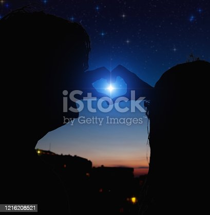 815224118 istock photo Couple making heart shape under the starry skies. 1216208521