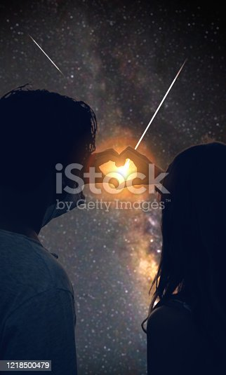 815224118 istock photo Couple making heart shape under the starry skies. 1218500479