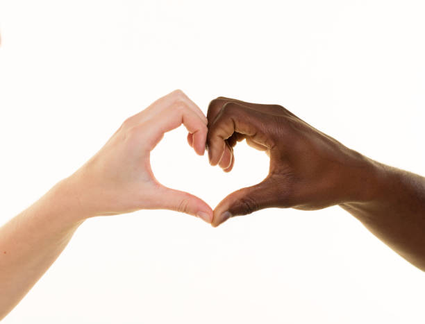 Couple making hearth shape with hands stock photo