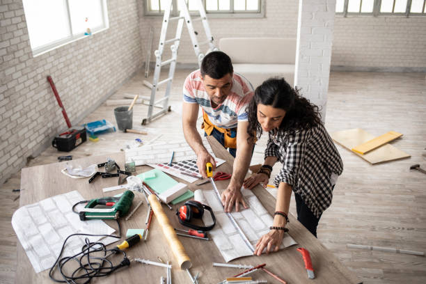 couple making home improvement and measuring - renovation stock photos and pictures