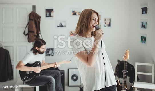849362192 istock photo Couple making music 849312738
