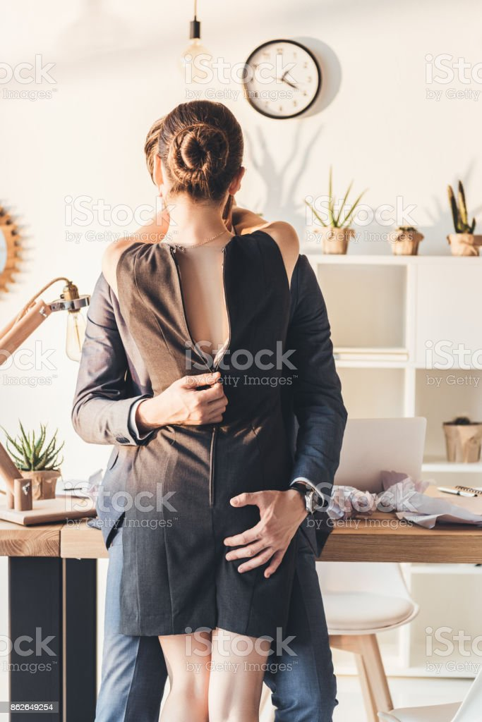 Couple making out in office stock photo
