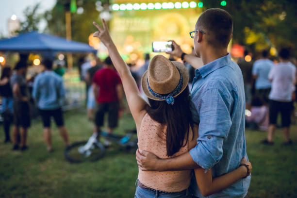 Couple making selfie on a music festival stock photo