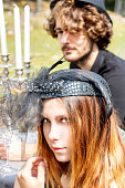 istock Couple man and woman in very chic steampunk vintage outfit during the celebration of the harvest festival - outdoor picnic 1174109312