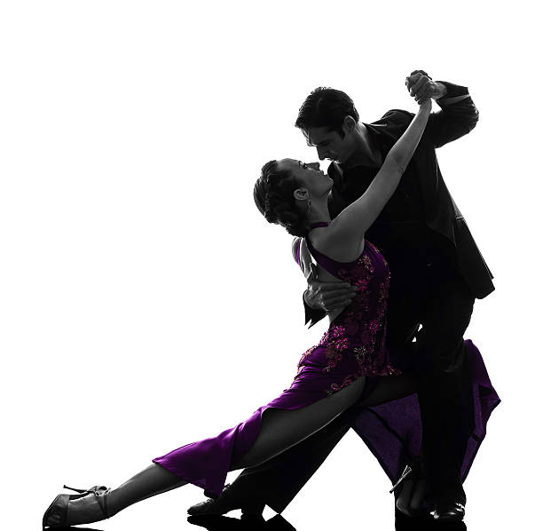 couple man woman ballroom dancers tangoing silhouette - music style stock pictures, royalty-free photos & images