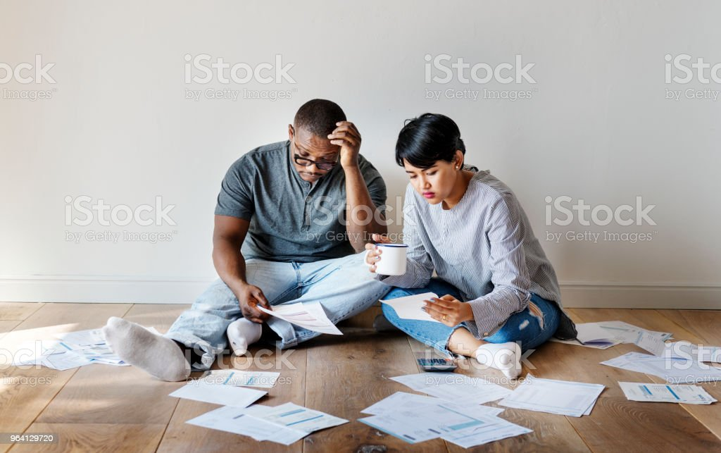 Couple managing the debt stock photo