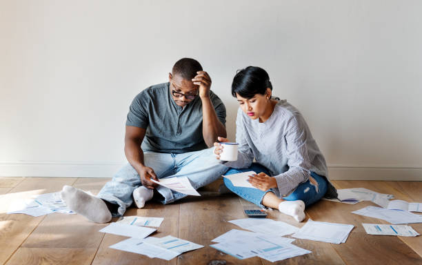 couple managing the debt - bills and taxes stock pictures, royalty-free photos & images