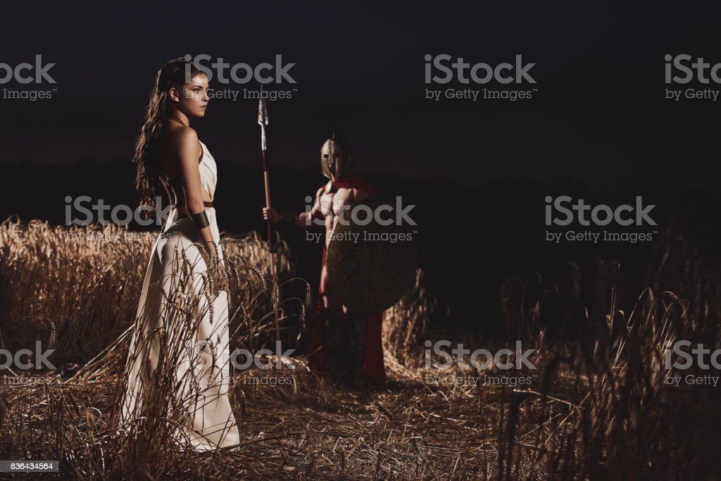 Couple meeting before war at field. stock photo