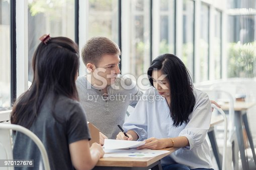 Couple meeting financial adviser for home, Woman putting signature on document loan contract, real estate purchase, success business contract deals with sale represent.