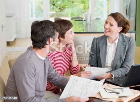 istock Couple meeting with financial advisor in dining room 89291848