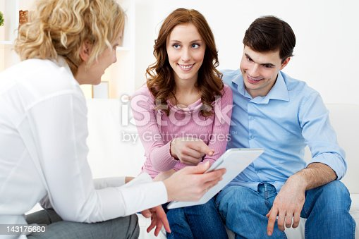 153136893 istock photo Couple Meeting With Financial Advisor 143175660