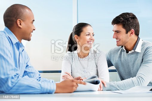 153136893 istock photo Couple meeting with financial advisor. 143176492