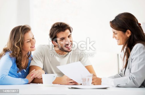 153136893 istock photo Couple meeting with financial advisor. 143920617