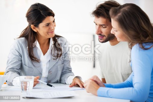 istock Couple meeting with financial advisor 153136893