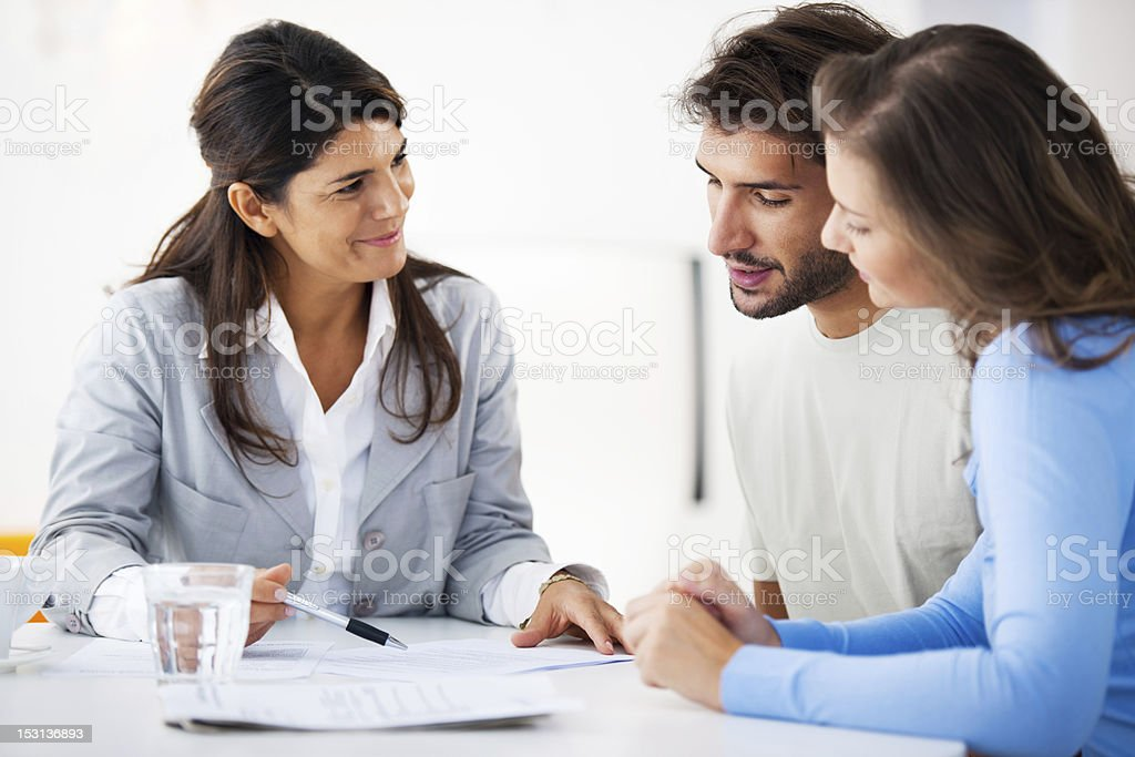 Couple meeting with financial advisor​​​ foto