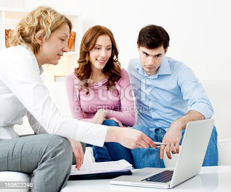 153136893 istock photo Couple Meeting With Financial Advisor 153822246