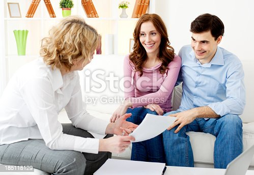 153136893 istock photo Couple Meeting With Financial Advisor 185118129
