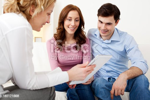153136893 istock photo Couple Meeting With Financial Advisor. 185121668