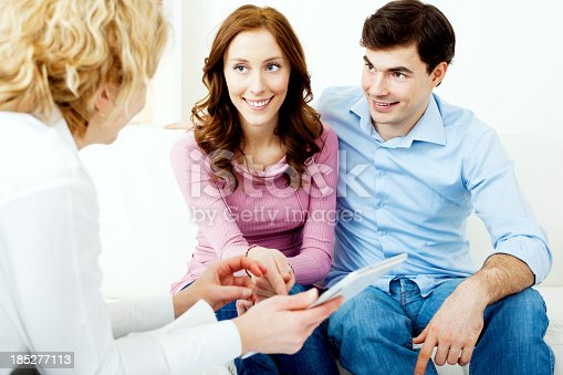 153136893 istock photo Couple Meeting With Financial Advisor. 185277113