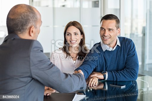 istock Couple meeting with financial advisor 842865024