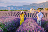 istock Couple men and woman on vacation at the provence lavender fields, Provence, Lavender field France, Valensole Plateau, colorful field of Lavender Valensole Plateau, Provence, Southern France. Lavender field 1266347273