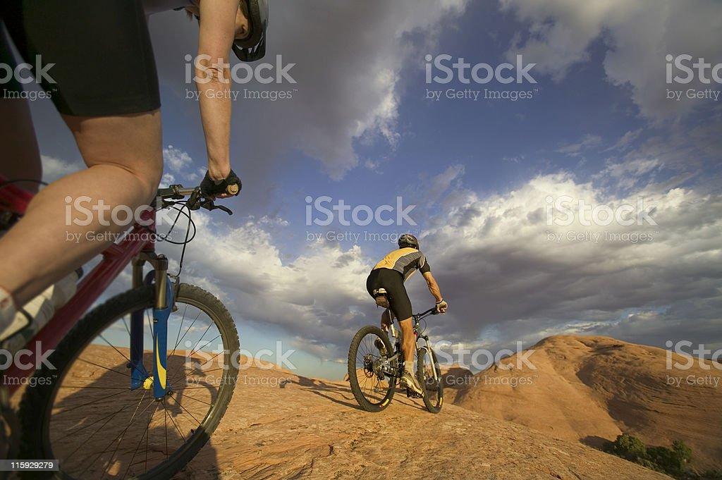Couple Mountain Biking in Moab, Utah royalty-free stock photo