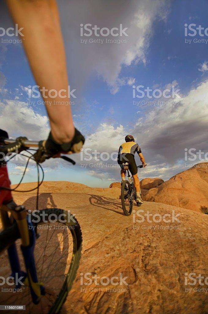 Couple Mountain Biking in Moab, Utah stock photo