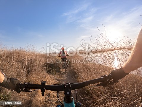 Couple mounting biking in public park: Shoreline at Mountain View, California, USA
