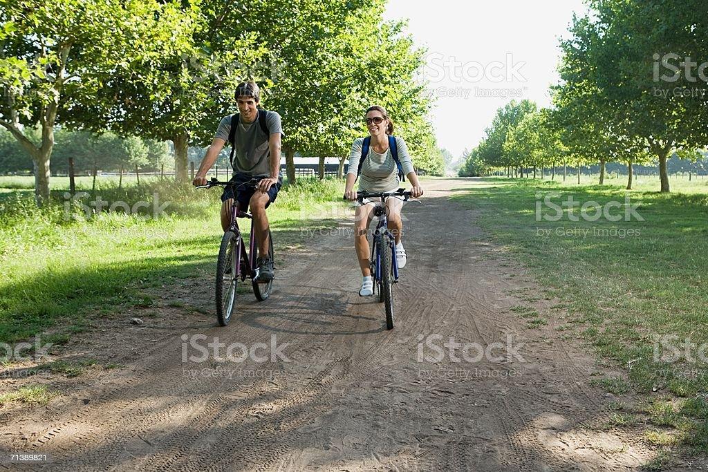 Couple mountain biking royalty-free stock photo