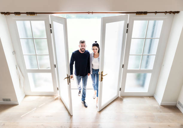 couple move to new house - house hunting stock photos and pictures