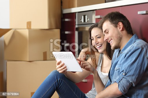 istock Couple moving home and buying online 621979364