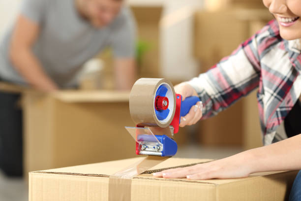 Couple moving home packing boxes stock photo