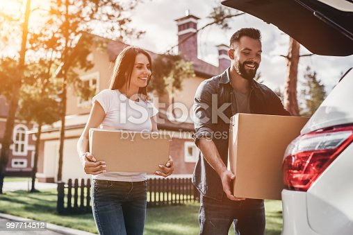 istock Couple moving in new house 997714512