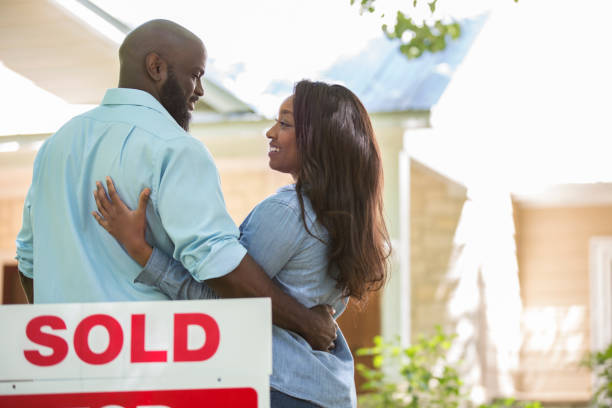 Couple moving into new home. stock photo