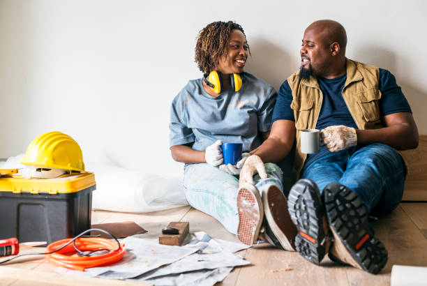 couple moving into new house - renovation stock photos and pictures